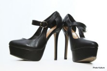 Black platform pump with cross-over side buckle by Charlotte Russe