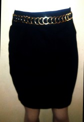 Black skirt with gold waist accessories. NGN 8000