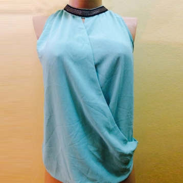 new...Light blue wrap top with silver and black sequins SOLD OUT