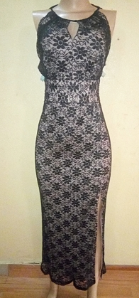 Black and champagne Lacey dress with a back cut out. NGN 25,000