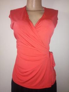 Anne Klein's orange wrap top NGN 6500