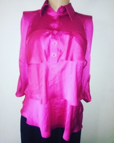 Layered pink top with foldable sleeves. N6,500