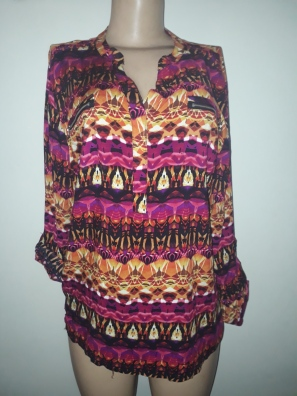 Multicoloured top with foldable sleeves. NGN 6000
