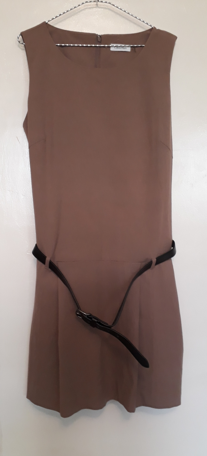 Light brown sleeveless belted dress by Calvin Klein. NGN 14000