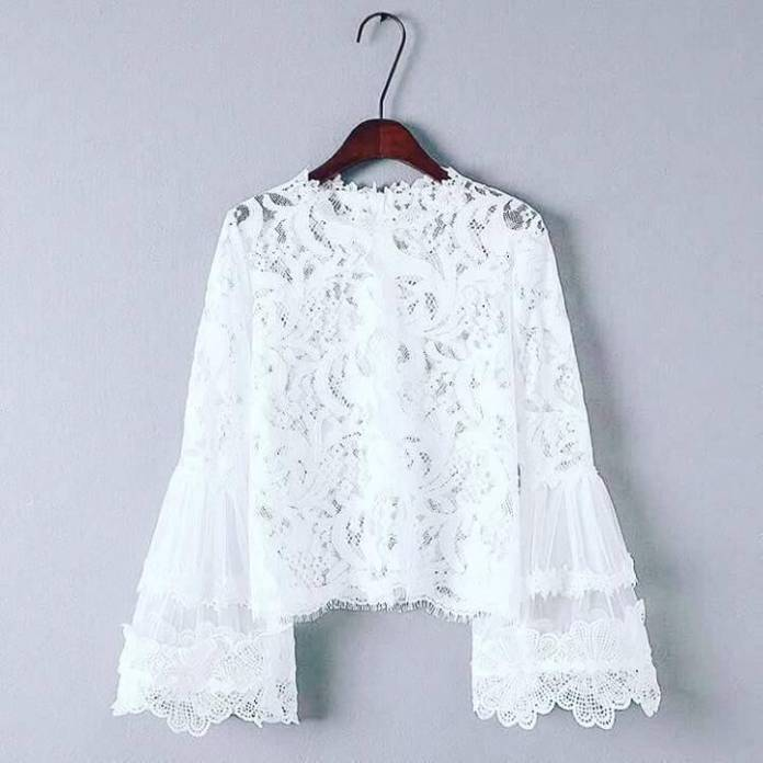 White lacey top wuth bell sleeves. NGN 7000