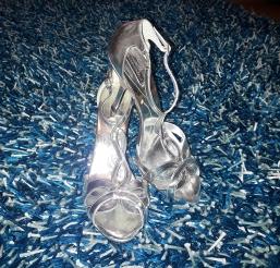 BCBG silver heely sandals. NGN 15,000