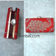 Peacock inspired red box clutch bag . NGN 8000