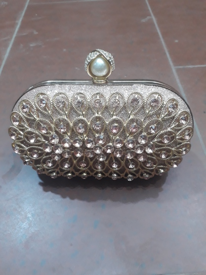 Honey bunch Silver clutch NGN 8000