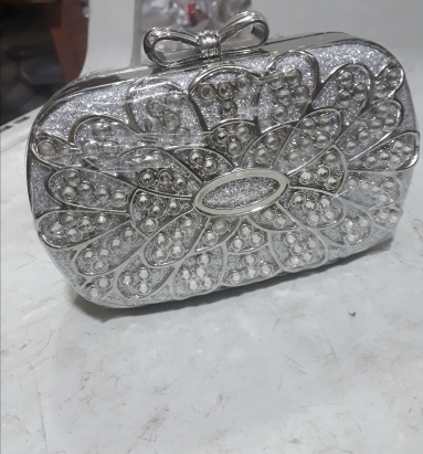 Classy steel silver clutch bag. NGN 12000