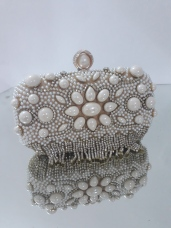 Pearl drop gold clutch. Also available in silver. NGN 12500