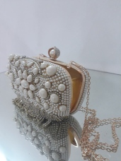 Pear drop gold clutch. Also available in silver. NGN 12500