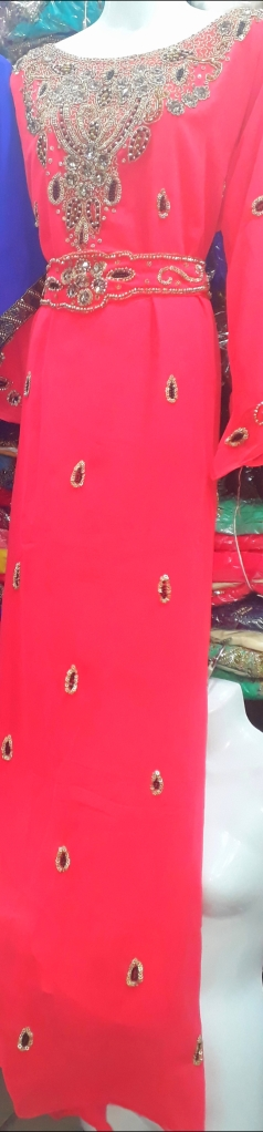 Coral stone beaded and belted Kaftan with extra detachable belt. NGN 20000SOLD OUT