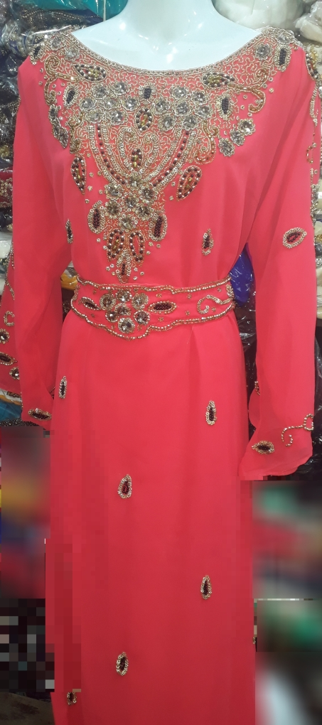 Coral stone beaded and belted Kaftan with extra detachable belt. NGN 20000