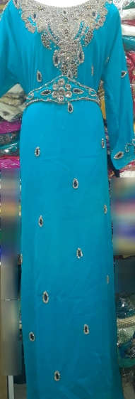 Torquoise blue stone beaded and belted kaftan with extra detachable belt. NGN 20000