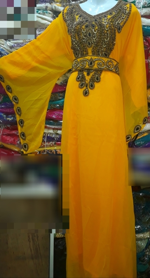 Mustard yellow belted and stone beaded Kaftan with extra detachable belt. NGN 20000