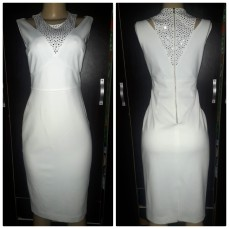 Off-site white hand beaded sequined Calvin Klein dress . NGN 25000