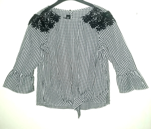 Checked top with black lace patches. NGN 7000