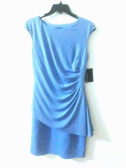 Light blue dress with glitters. NGN 125000SOLD OUT