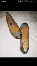 Flat shoes by Coach. NGN 15000