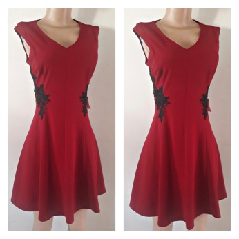 Short V necked dress with side black lace patches. NGN 12000