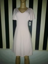 Light peach flared dress with caoe sleeves by Calvin klein dress. NGN 15000