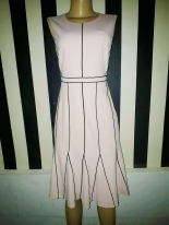 Light peach 4 pc dress with black lined stripes by Calvin Klein. NGN 22000SOLD OUT