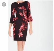 Floral black and orange dress with bell sleeves by Calvin Klein. NGN 185000SOLD OUT