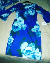 Straight cut floral dress with bell sleeves by Calvin Klein . NGN 18500