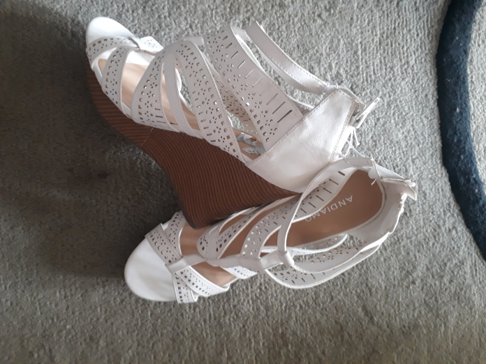 White leather wedges. NGN 13000