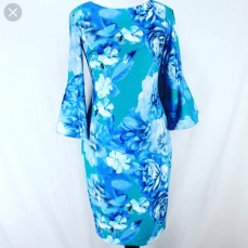 Floral midi dress with bell sleeves by Calvin Klein. NGN 18500