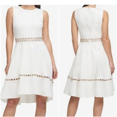 DKNY gommet scuba fit abd flare off white dress. NGN 25000