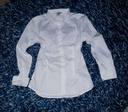 White stretch H and M shirt with foldable sleeves. NGN 6000