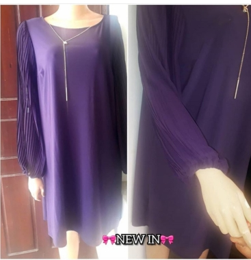 Free purple dress with pleated sleeves. NGN 15,500