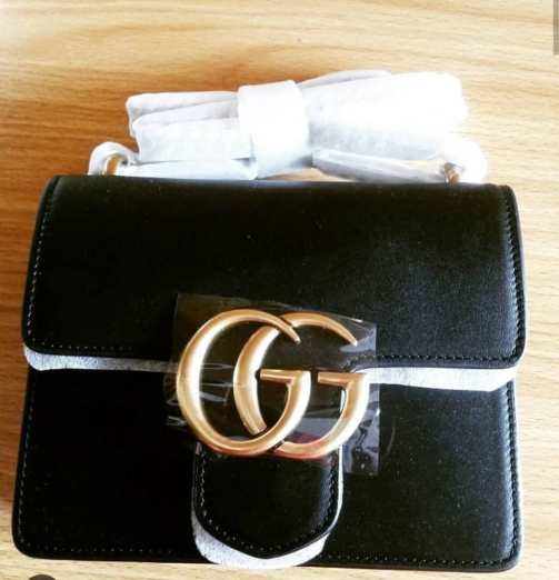 Black Gucci bag with chain NGN 80,000