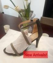 Army grren studded heely sandals. NGN 16000