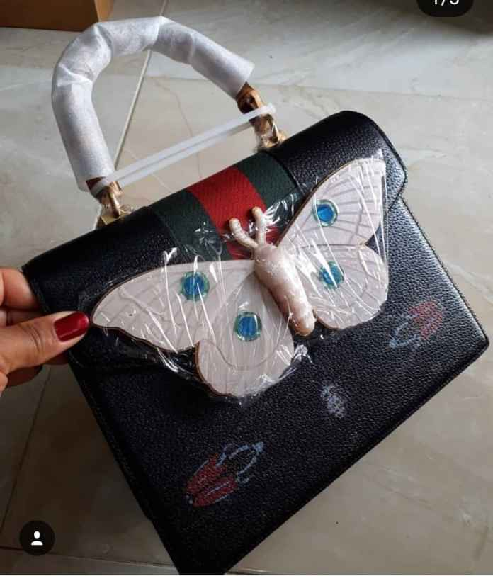 Gucci handbag with bamboo handle. Long strap present. NGN 120000