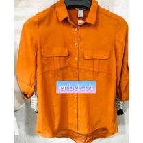 Burnt orange short sleeved top with turn up. NGN 6000